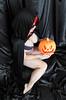Halloween Witch 5 (M Corbin) Tags: halloween witch jackolantern pumpkin blacknecklace blacksatin feet legs busty model pose curves redlipstick redhair rednails boudoir hot black