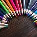 Color pencils forming a semicircle
