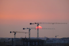 Work in progress (JarHTC) Tags: fujifilm xe2 crane sunset work build three sun orange