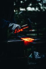 between the hammer and the anvil (FButzi) Tags: orange light caprese michelangelo festa del marrone castagna toscana tuscany italy hand glove hammer anvil heat