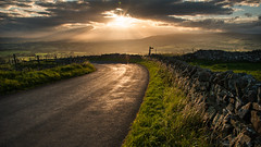 Finding the Path (gewilliams_photography) Tags: sunset sundown sun clouds road path stone countryside hills rollinghills grass
