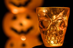 Only if you dare you can shot a skull... or is it scull a shot? (Amy Maher) Tags: spook faces pumkins skull shadow orange macromondays hmm halloween