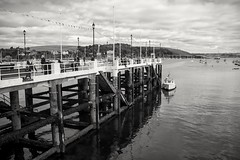 Prince of Wales Pier, Falmouth, Cornwall, UK. (Mark Curnow Photography) Tags: princeofwalespier falmouth cornwall history blackandwhite monochrome greyscale vignette harbour boats tourism cornish autumn fall season outdoorphotography outdoors canonphotography people walk bunting