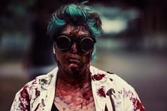 Mad scientist (Adam R.T.) Tags: zombie apocalypse zombiewalk portrait blood makeup wedding contrast decay spooky girl woman blurry insane fun fantastic wound creepy