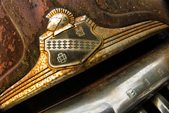The knight in rusting armour (ISP Bruno Laplante) Tags: hood ornament chrome oldsmobile eight vintage car decay rust orange decaying