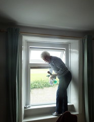 My mother decided that my windows were not clean enough.... don't know whether to feel ashamed, guilty or just delighted that she is here to help... lol... (Sue - busy for a few days.... still happy sparrow.) Tags: windows cleaning rainy housework mother dirt