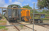 FGC GE 44 Ton Yard Locomotive #100, behind the Fence at Willow Yard (gg1electrice60) Tags: notrespassing fgcnumber100 floridagulfcoastno100 44toncentercabswitcherfgc100 centercabswitcher ge44tonlocomotive ge generalelectric fgcx100 reportingmarksfgcx100 donatedbyusnavy1995 jacksonvillenavalairstation parrish willow willowroad willowrd manateecounty usroute301 us301 route301 usn6500345 formerusnavy6500345 diesellocomotive dieselengine builtbyge passengercars railcars rollingstock floridarailroadmuseum frm frrm goldcoastrailroadmuseum gcrm gcrrm unitedstates usa us america northofparrish railroad railroadyard railroadstation railroaddepot railroadmuseum railroadtracks rrtrack rr rrdepot rrmuseum rrtracks rryard railyard railcar fence cyclonefence chainlinkfence museum rrstation touristrailroad touristexcursions tourists railfanexcursions railfans excursions train trainstation trainmuseum trainrides displays ondisplay rustyandcrusty rustycrusty passengercar passengercoach florida