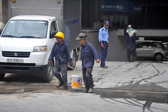 Sharing the load (Roving I) Tags: workers workmen helmets carrying sharingtheload heavy weight basements parking security guards uniforms loads hardhats facemasks fhomes apartmentbuildings danang vietnam