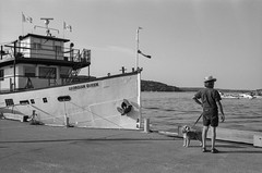 Waiting for a boat (dennisfromthere) Tags: analog street photography bw ontario canada monochrome blackandwhite bandw 2017 noiretblanc outdoor people nikon september f3 classicblackwhite lake ship vacation country heat penetanguishene penetang harbour georgian bay