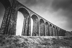 Across the dale (Anthony P26) Tags: architecture category england hdr northyorkshire places ribblesdaleviaduct travel yorkshire viaduct grass building structure bridge sky landscape travelphotography architecturephotography cloudy misty greyskies greyclouds perspective angle pattern lines arches battymossviaduct rain mist canon canon1585mm canon70d railway victorian outdoor blackandwhite mono monochrome whiteandblack bw
