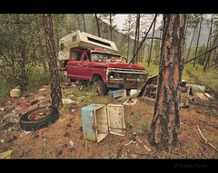 washout (Gordon Hunter) Tags: camp camping bush campsite camper rv truck old red ford 4x4 quad cab 4door forest random spot awayfromitall trees wilderness pine cooler tire propane tank junk mess trash hoarder rain wet stuck fading failing rough real woods outdoor harsh nature fraser canyon bc canada gordon hunter nikon d5000 summer june auto