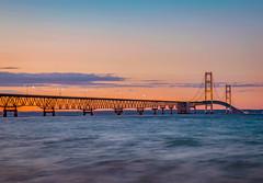 Sundown at the Bridge (T P Mann Photography) Tags: lake evening dusk long exposure shore clouds sky canon orange lights traffice light stream waves motion