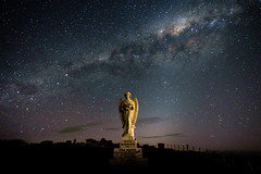 If only she could turn around Pt IV (ajecaldwell11) Tags: night milkyway ankh astrophotography stars grave cemetery light sculpture southerncross hawkesbay newzealand stoneangel headstone sky statue pakipaki caldwell clouds angel