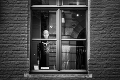 Uncomplaining (_MootMoot_) Tags: bruges brugge belgique belgium noiretblanc nb noir blanc monochrome bw blackwhite blackandwhite black white visage candid city contact eyecontact eyes eye canon texture woman waiting window fenetre light wall haunted girl femme f18 street stphotographia inside urban usm rue alone autumn automne seul mannequin wear transparence transparency 70d 50mm reflection transparent mode fashion display shopwindow shop store magasin dummy dummies impassible impassive uncomplained