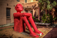 The Sitting Red Man (donnieking1811) Tags: santafe newmexico museumofcontemporarynativearts art exhibit sittingredmanstatue courtyard hdr canon 60d lightroom photomatixpro flickrcolour