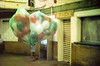 Subway Balloon (Past Our Means) Tags: cinestill 800t film canon ae1 p balloons lady subway newyorkcity new york historical vintage 35mm 50mm analog analogue filmisnotdead filmphotography istillshootfilm adventures wanderlust lowlightphotography