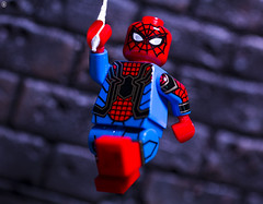 Spider-Man Swing's into action (jezbags) Tags: lego legos toy toys custom canon60d canon 60d 100mm closeup upclose macro macrophotography macrodreams macrolego marvel marvelstudios legomarvel spiderman spidey swing wall rock peter parker avengers