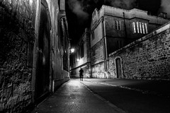 Oxford Nights - Strange Apparition (Monochrome) (DarrenCowley (away, back January)) Tags: brasenoselane oxford medieval shadows silhouette cobbledstreet walls architecture vanishingpoint