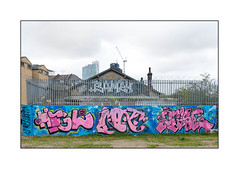 Street Art (2Rise & Friends), East London, England. (Joseph O'Malley64) Tags: 2rise ghostwriters ghostwriterscrew streetartist streetart urbanart publicart freeart graffiti eastlondon eastend london england uk britain british greatbritain art artist artistry artwork mural muralist wallmural wall walls brickwork bricksmortar cement pointing securityfencing steelfencing securityspikes razorwire buddleia buddleiaflorets victorianbuildings victorianstructures chimneys chimneypots flats blockofflats officeblocks towers building construction change gentrification creepinggentrification openground urban urbanlandscape aerosol cans spray paint fujix x100t accuracyprecision