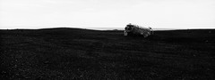 DC 10 plane wreck, Iceland, xpan (Fabio Stoll) Tags: analog black white fomapan action 400 self developed ishootfilm filmisnotdeat einfarbig hasselblad xpan ii outdoor camping landschaft abhang feld fotorahmen breitformat iceland geisir drive roadtrip nature moody fomatol lqn wasser himmel haifoss foss glacier gras felsen dc 10 plane wreck