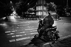 Easy Rider. (Presence Inc) Tags: night portrait rx1rm2 people abstract 35mm nightlife colour shadows photograph silhouette citylife filmmood architecture jakarta transport texture architectural angles fullframe wideangle street rx1r decay streetphotography bw simplicity indonesia spaces light nightpeople lowlight backlit contrast mood isolated cinematic dark photography sony stilllife society mirrorless urban candid urbanscape