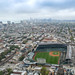 Aerial of Wrigley Field stadium with Chicago skyline in the background