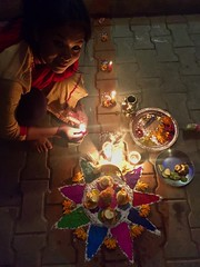 Celebration Tradition Candle Indoors  High Angle View Cultures Flame Human Representation Religion Night Holiday - Event Illuminated Celebration Event Childhood Spirituality Table Real People Tihar Laxmipuja PhotoNepal Festival Nepali Culture