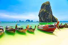 Longboats on Railay beach (ffmtor) Tags: beach thailand railay krabi sea andaman water nature travel vacation landscape blue asia thai sky tropical summer island resort coast shore sand cliff sun ocean crabi paradise rock mountain day white destination bay boat longboat ukraine