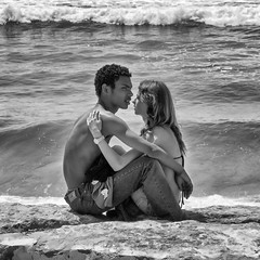 'Young Love' (Canadapt) Tags: couple teenagers man woman embrace ocean wave beach bw costadacaparica portugal canadapt