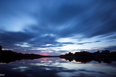 Sunset on the Merrimack (MikeWeinhold) Tags: merrimackriver lowell sunset newengland massachusetts sky longexposure clouds water reflection