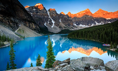 Sunrise at Moraine Lake (lsten) Tags: peaceful hills alpenglow summer tripod amateurphotography iconic alberta sky nisifilters wideangle graduatedndfilter nationalpark mountains scenery formatthitech forest canonef1635mmf4lisusm green morainelake mountain majestical 21mm tranquility clearskies sharp nature water lake snow banffnationalpark tree peak landscapephotography golden boat formatthitechcolbybrownsignature view viewingpoint rock silhouette natureview calm cliffs amazing trees iso100 cliche travelphotography magnificent still rocks paradise lakelouise morning colorful serenity beautiful theunforgettablepictures canoneos5dmarkiv f13 singleshot colors canada naturephotography landscape stunning nisicpl