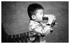 Thirsty,Foma Retropan 360 (cupitt1) Tags: boy child asian drink can pop softdrink fizzy retropan foma eos 3000f monochrome