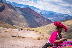 A local woman sells coca leaves for those suffering from altitidue sickenss on the descent from Asungate mountain.