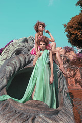 Cotton candy twins (jenny_yoshiko) Tags: twins sisters pink turquoise stone statue mouth blue dress designer light fashion style siblings desert rose model