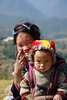 Happy mum, angry baby - Sapa - Vietnam (gabrielfiuza) Tags: colors social woman countryside travel landscape rice hike asia vietnam smile baby people portrait