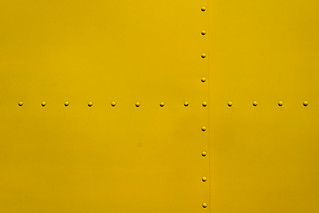 Rivets on a yellow panel