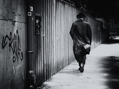 urban cowboy (Sandy...J) Tags: urban noir olympus photography man walking blackwhite bw monochrom street streetphotography germany city black white alone