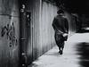 urban cowboy (Sandy...J) Tags: urban noir olympus photography man walking blackwhite bw monochrom street streetphotography germany city black white alone