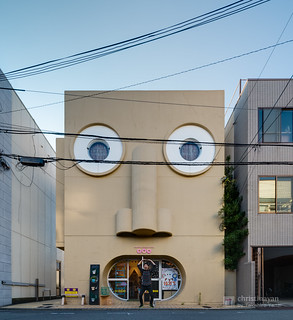 Me and the facade of The Face House (顔の家)