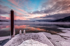 Winter Makes Me Think of Glacier National Park (rebeccalatsonphotography) Tags: sunrise morning snow mist fog pink blue dock boatdock lake lakemcdonald np nationalpark glacier glaciernationalpark montana mt landscape canon wideangle belowzero winter january rebeccalatsonphotography