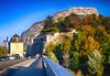 Mountainside view in Grenoble, France (` Toshio ') Tags: toshio grenoble france europe european europeanunion mountain autumn fall trees leaves french bridge bastille fujixt2 xt2 road street flag frenchflag people cars