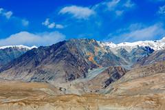 Along the Karakorum Highway (Chris Redan) Tags: xinjiang mountain mountains sky clouds blue colors karakorum highway china kashgar snow capped canon mark iii 5d 100400mm contrast zoom landscape