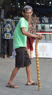 old man with unusual bamboo cane