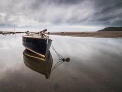 Newport Reflections (Timothy Gilbert) Tags: wales panasonic1235mmf28x beach water reflection newport still boat panasonic gx8 pembrokeshire clouds