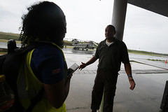 A member of a Foreign Office Rapid Deployment Team talks to airport staff during a humanitarian needs assessment mission to Dominica.