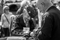 Blackface Sheep (Silver Machine) Tags: scotland dufftown 125thdufftownhighlandgames highlandgames portrait man smoking drinking outdoor flatcap beer fujifilm fujifilmxt10 canonfd85mmf18