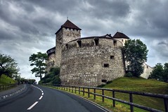 The castle of the Prince of Liechtenstein (PeterThoeny) Tags: vaduz fürstentumliechtenstein principalityofliechtenstein liechtenstein schlossvaduz castlevaduz castle architecture building roof tower medievalcastle medieval road street day sky cloud cloudy 1xp raw sony sonya7 a7 a7ii a7mii alpha7mii ilce7m2 fullframe fe2870mmf3556oss photomatix hdr qualityhdr qualityhdrphotography grass fav200