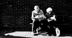A bit of light reading (phil anker) Tags: mono street bench shadows salisbury fujix70
