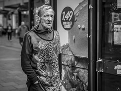 Call of the Wild (Leanne Boulton) Tags: urban street candid portrait portraiture streetphotography candidstreetphotography candidportrait streetportrait streetlife eyecontact candideyecontact man male old aged elderly face facial expression look emotion feeling mood style fashion leopard weathered juxtaposition tone texture detail depthoffield bokeh naturallight outdoor light shade shadow city scene human life living humanity society culture lifestyle people canon canon5d 5dmkiii 70mm character ef2470mmf28liiusm black white blackwhite bw mono blackandwhite monochrome glasgow scotland uk