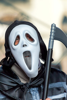 A man in a scary Halloween mask